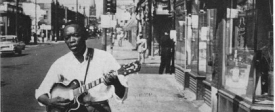 John Lee Hooker on Hastings Street, Detroit, 1959. © Jacques Demêtre / Soul Bag Archives